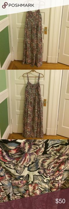 """French Connection size10 floral pleated maxi dress Pink, white, blue, black large floral printed maxi dress by French Connection (size 10). The skirt is pleated but not a ton of pleats, the top has a v-neck cut, straps are not adjustable, and the back has an exposed zipper. Never worn it, bought it for a trip and just decided not to wear it (the French connection brand tag is still attached but I think the barcode tag came off in the suitcase or something). Length is 52"""" from v-neck French…"""