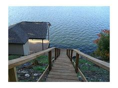 Walkway from house to private dock Lakefront Homes For Sale, Real Estate Buyers, Boat Dock, Walkway, Garden Bridge, Arkansas, Family Room, Outdoor Structures, House