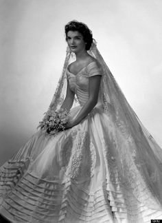 """Jacqueline Kennedy Onassis in her wedding gown 12 September 1953. ..cited as iconic and one of the best-remembered bridal gowns of all time. The wedding gown was the creation of Ann Lowe (49 ft) of ivory silk taffeta. The veil, was the one worn by her grandmother in her wedding.[2] Ann Lowe, who made the gown and also held the trail, was not given due credit by name."" truncated from http://en.wikipedia.org/wiki/Wedding_dress_of_Jacqueline_Bouvier"