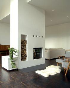 log storage and modern fireplace