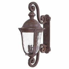 """Featuring textural glass panels and a vintage rust finish, this classic outdoor wall lantern illuminates your front door or patio in timeless style.  Product: Wall lanternConstruction Material: Metal and glassColor: Vintage rust Features: Textured glass panels Accommodates: (1) Bulb - not includedDimensions: 36.5"""" H x 15"""" W x 22"""" D"""