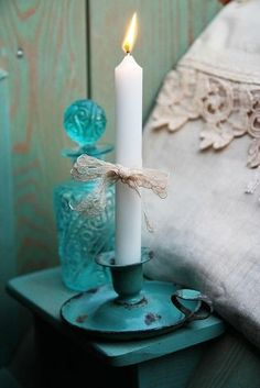 Candles:  Rustic turquoise candle holder.