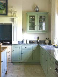 Lovely traditional kitchen. Units painted in Farrow and Ball Breakfast Room Green and Dix Blue, Sanderson fabric, Kitchen units by Design Matters. Interior design by Angel and Blume, photography by Simon Whitmore photography
