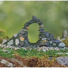 Woodland Stone Arch is an enchanting entrance to any fairy garden. Pass through this arch and be mystifies to see all the wonders of a fairy garden! Dimensions: