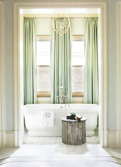Beautiful bath - love the soaking tub and soft green window treatments...