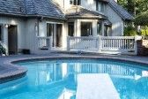 Heated Outdoor Swimming Pool With Large Home In Background With.. Royalty Free Stock Photo, Pictures, Images And Stock Photography. Image 14345334.