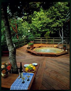 Redwood deck outside kitchen with sunken hot tub.  Would this work for you?? ;)