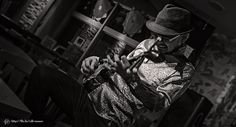 Okinawan folk singer and sanshin player Toru Yonaha performs at an Okinawan Bar in Nishihara, Okinawa.