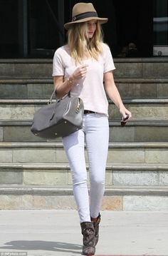 California cool: Rosie Huntington-Whiteley breezes out of a furniture store in Los Angeles on Friday, gorgeous in a wide-brimmed hat