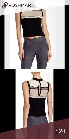 Free People Crop Top A back keyhole serves skin flash on a mock neck midriff sweater tank, featuring colorblock construction. Mock neck, sleeveless. 61% cotton, 39% polyester. Machine wash cold. Free People Tops Crop Tops