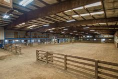 The farm features multiple barns, garages, and storage areas, an outdoor arena, fenced paddocks, multiple parking areas, and a 210x136 indoor arena with adjacent stalls, elevated observation room, offices, large kitchen, bathroom facilities, hot walker, hydrotherapy pools, and covered entrance area. Additional housing includes two 2 bedroom apartments, a 1 bedroom apt, and  dormitory-style accommodations.