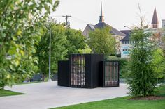 atelier kastelic buffey installs a miniature library in a toronto suburb