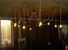 Golden fabric chandelier with textile cable. by PrimaElectro