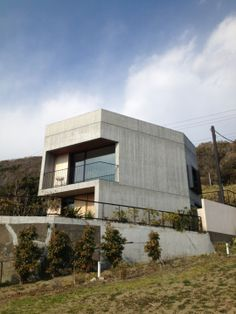 House in Akiya by Nobuo Araki/The Archtype. This is a two-story weekend house with a rooftop deck in Akiya. The house faces the ocean while its backside greets the mountains. It has a rooftop deck.  The windows have sliding shutters for protection. https://architizer.com/projects/house-in-akiya/