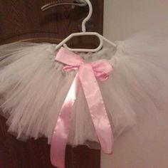 white tutu with pink ribbon