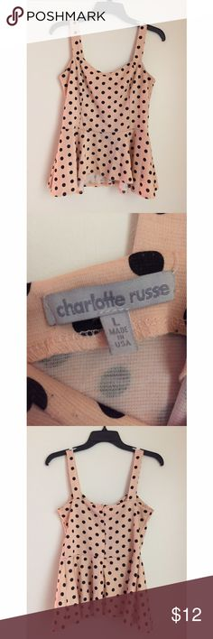 Polka-dot Peplum Adorable pink peplum with black polka dots, has a zipper in the back! 😊💕 Charlotte Russe Tops Tank Tops