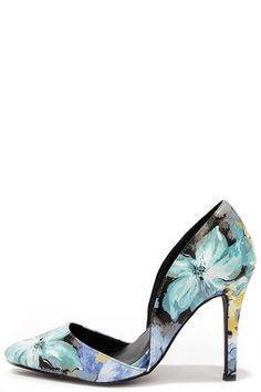 "There's nothing like fresh flowers in the house, and the Elegant Arrangement Blue Floral D'Orsay Pumps to step out in! A two-piece pointed toe upper is perfect in shades of blue and teal over smooth vegan leather, with notchy d'Orsay cutouts at the sides. 4"" wrapped stiletto heel. Cushioned insole. Rubber sole has nonskid markings. Available in whole and half sizes. Measurements are for a size 6. All vegan friendly, man made materials. Imported."