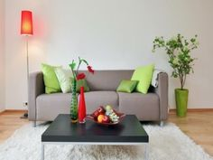 Brighten up the wintery grey lounge suite with a splash of lime green and orange with scatter cushions and accessories from Mr Price Home for that Spring look.