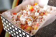 Halloween Popcorn 2 bags microwave popcorn, popped 1 bag candy corn 1 16-ounce package white chocolate bark* Halloween sprinkles wax paper
