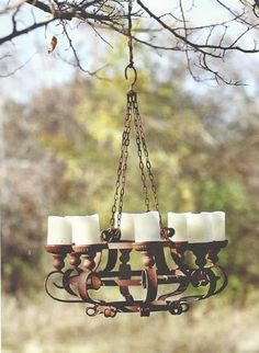 Lovely grand metal candle chandelier with a soft glow creating a lovely ambiance for outdoor dining and enjoyment. Visit Antique Farmhouse for even more metal chandeliers and vintage style decor. Twig Chandelier, Farmhouse Chandelier, Outdoor Chandelier, Rustic Lighting, Outdoor Lighting, Pergola Lighting, Lighting Ideas, Kitchen Lighting, Rustic Candles