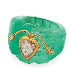 Carved emerald and diamond ring.