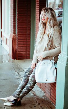 camo and neutral sweater, white purse