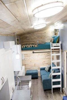 The Brown Bear tiny house has a loft master bedroom for the parents and split loft bedrooms for the kids.