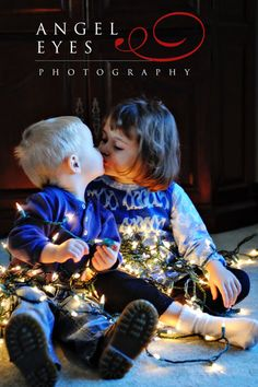 Kissing kids with Christmas lights. Photo by Hilda Burke  http://www.angeleyesphotography.com/  http://www.angeleyesphotographyblog.com/