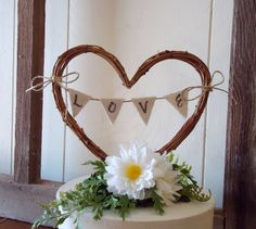 Wedding Cake Topper Rustic Heart with LOVE Banner - 5 in. | twig arch would be great and the porselain figures underneath with real flowers. How that sounds?