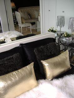 Gold finger inspired bed dressing... black satin sheets, black fur & gold  toss pillows & white fur throw