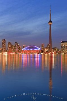 Photo of Toronto City Skyline seen at dusk from Centre Island, Toronto Islands, Lake Ontario, Ontario, Canada. Toronto Skyline, Toronto City, Toronto Canada, Quebec, Places To Travel, Places To See, Travel Destinations, Calgary, Vancouver