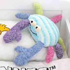 Knitting Pattern for Crab Pillow -This cuddly crab is easily customized to different sizes by using different weights of yarn. Great stash buster!  http://intheloopknitting.com/sea-animal-knitting-patterns/