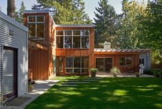 Really like the use of glass and wood, the L shape creating a lovely courtyard.  Joyous Renovation contemporary exterior.