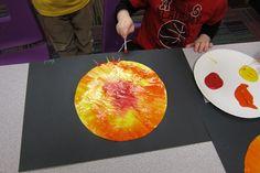 Paint the sun:  paper disc, paint, saran wrap