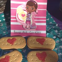 """Doc McStuffins party: """"Band-Aid Cookies"""" Vienna Fingers & Pink Gel frosting."""