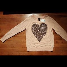 H&m light pink sweater with gold sequin heart (XS) (NWT) light pink long sleeve sweater with large gold sequin heart in the middle. There are no wears, stains, or rips. No trading, only purchase through posh. Great for a holiday look! The 4th pic is dedicated to a fashionista blogger ! H&M Sweaters