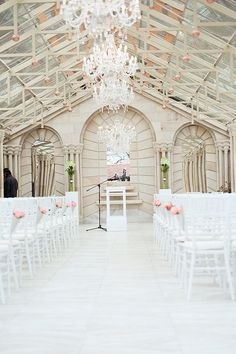 21 Amazing Wedding Arch and Canopy Ideas: The chandeliers hanging from this absolutely spectacular glass walled wedding venue created a canopy of light Burlap Wedding Arch, White Wedding Arch, Wedding Ceremony Arch, Wedding Canopy, Outdoor Wedding Venues, Indoor Wedding, Wedding Bells, Wedding Flowers, Wedding Dress