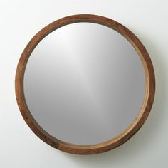 natural perspective.  Solid sustainable acacia wood comes full circle to showcase a sweeping grain and warm hi/lo tones.  Spanning two feet in diameter, handcrafted wooden frame rings the inset mirror with 3D depth. HandcraftedSolid sustainable acacia woodDue to natural characteristics of wood, tone and grain will vary; each is uniqueGlass mirrorWipe with soft, dry clothMade in India.