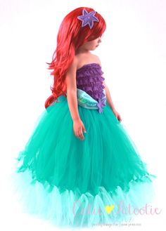 This listing is for one Tidal Wave Teaser tutu skirt. ***This skirt is custom made to order.  ***Beaded headband is sold separately. ***Red wig sold separately. ***Purple ruffle romper sold separately.  ***Additional color options available for purchase in our shop.  --------------------- ITEM DETAILS --------------------- This tutu skirt is finished with a coordinating satin ribbon, sequined tulle waist and beaded felt flower. Sequin sash is attached to the skirt and cannot be sold…