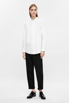 COS Straight-fit cotton shirt in White. White minimalist shirt | Simple white shirt | Long white shirt | Minimalist style | Capsule wardrobe | Simple style | Less is more
