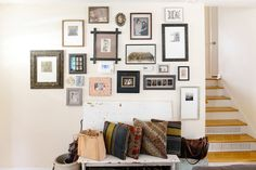 A collection of family photos, vintage photos and artwork adorn the entryway. The tintype of Jessica and Andrew is by Giles Clement.