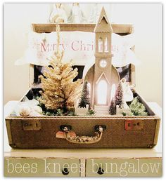 Christmas in a suitcase.  I love this idea ! (pinned from Bees Knees Bungalow)