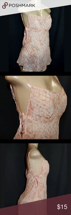 """Cream Victoria secret sheer chemise silk nightie S You are looking at a sexy pink peachy sheer chemise. This has adjustable straps and ties on the sides. This is in great condition there is nothing wrong with it. Materials: Bust:30""""-34"""" waist:36""""-40"""" 17"""" long from underarm to bottom seem Victoria's Secret Tops Camisoles"""
