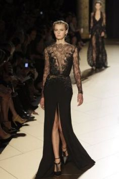 A model wears a creation by fashion designer Elie Saab during his Womens Fall Winter 2013 haute couture fashion collection in Paris, France, Wednesday, July 4, 2012. (AP Photo/Francois Mori) (AP)