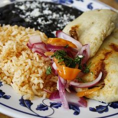 Tuesday Lunch Special at TNT Taqueria! Chipotle-Carnitas Tamales with pickled red onions. Served with rice & black beans. #lunchtime #Wallingford #Seattle #MexicanFood #TNTTaqueria