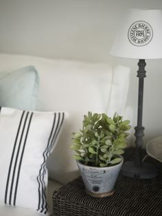 Lene Bjerre - SPRING 2013.   LAURIE cushion (item no. 613016807) FREYA lamp and MONOGRAM SEAL shade (item no. 153004517 and 242018109) STINE flower pot (item no. 304401403)