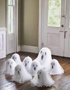 never would have thought! honeycomb (wedding) bells as ghosts! with cheese cloth covered on top....