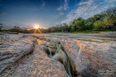 McKinney Falls State Park in Texas. This park is from lava flows. Has several waterfalls and a cave shelter where Indians used to hang out.