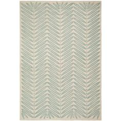 Hand-tufted wool rug with chevron leaf motif.Product: RugConstruction Material: WoolColor: Blue f...