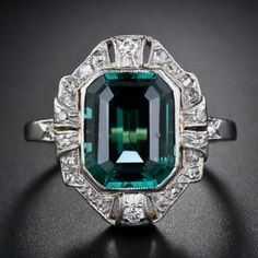 A bright electric teal green emerald-cut tourmaline is beautifully presented in platinum over gold, and almost half a carat of old-cut diamonds, in this stunning, colorful and far-from-ordinary cocktail ring of early twentieth-century vintage. Antique Rings, Vintage Rings, Antique Jewelry, Vintage Jewelry, Gems Jewelry, Art Deco Jewelry, Jewelry Accessories, Gold Jewellery, Jewlery